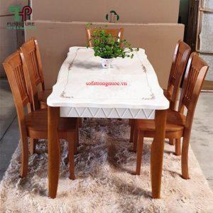 bàn ăn mặt đá khung gỗ